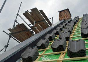 Kopgevelafdekkers in Belgisch hardsteen